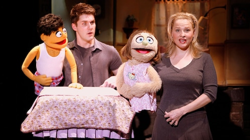 Puppets and actors in a scene from Avenue Q off broadway in New York