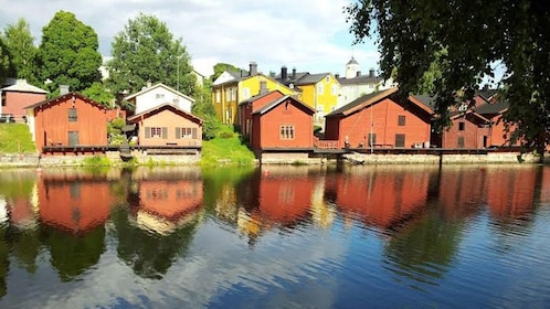 Colorful homes line a river in Porvoo