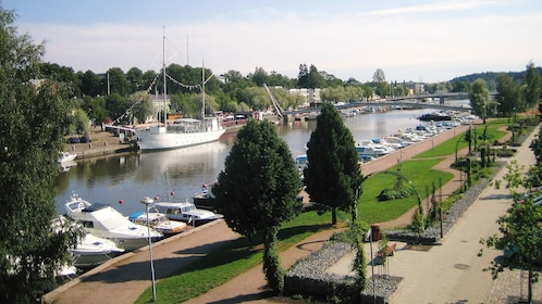 Boats docked along a river in Porvoo