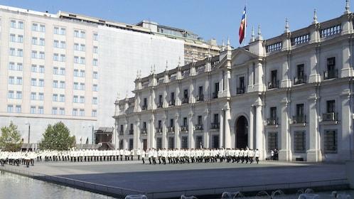 Palacio de La Moneda with soldiers marching in Santiago