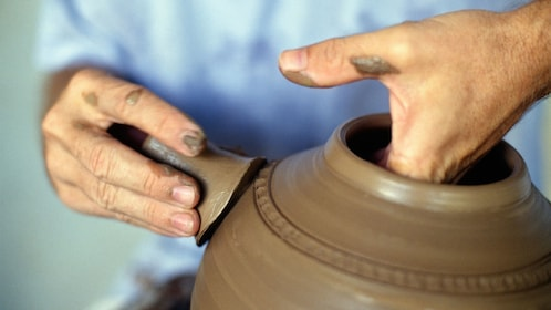 Making clay pottery in Cannes