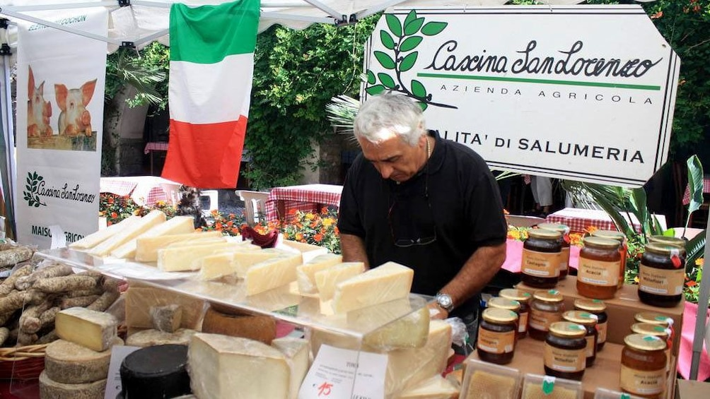 Show item 2 of 5. Shopping for Italian cheese at the market in Cannes