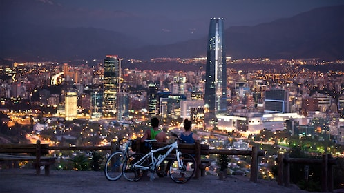 Looking down at the city at night from a scenic viewpoint in Santiago