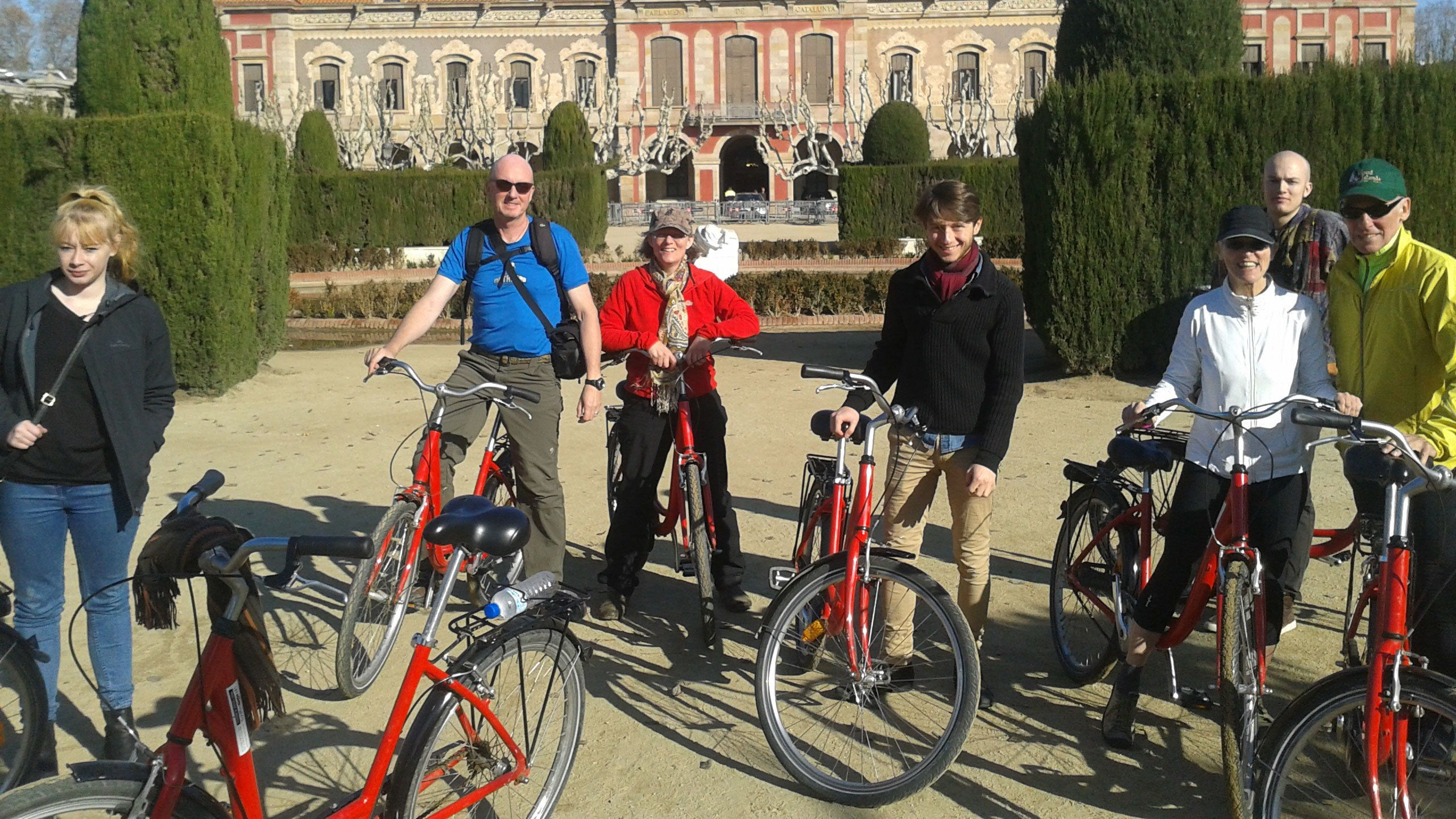 six people standing next to their bikes on sightseeing tour in Barcelona