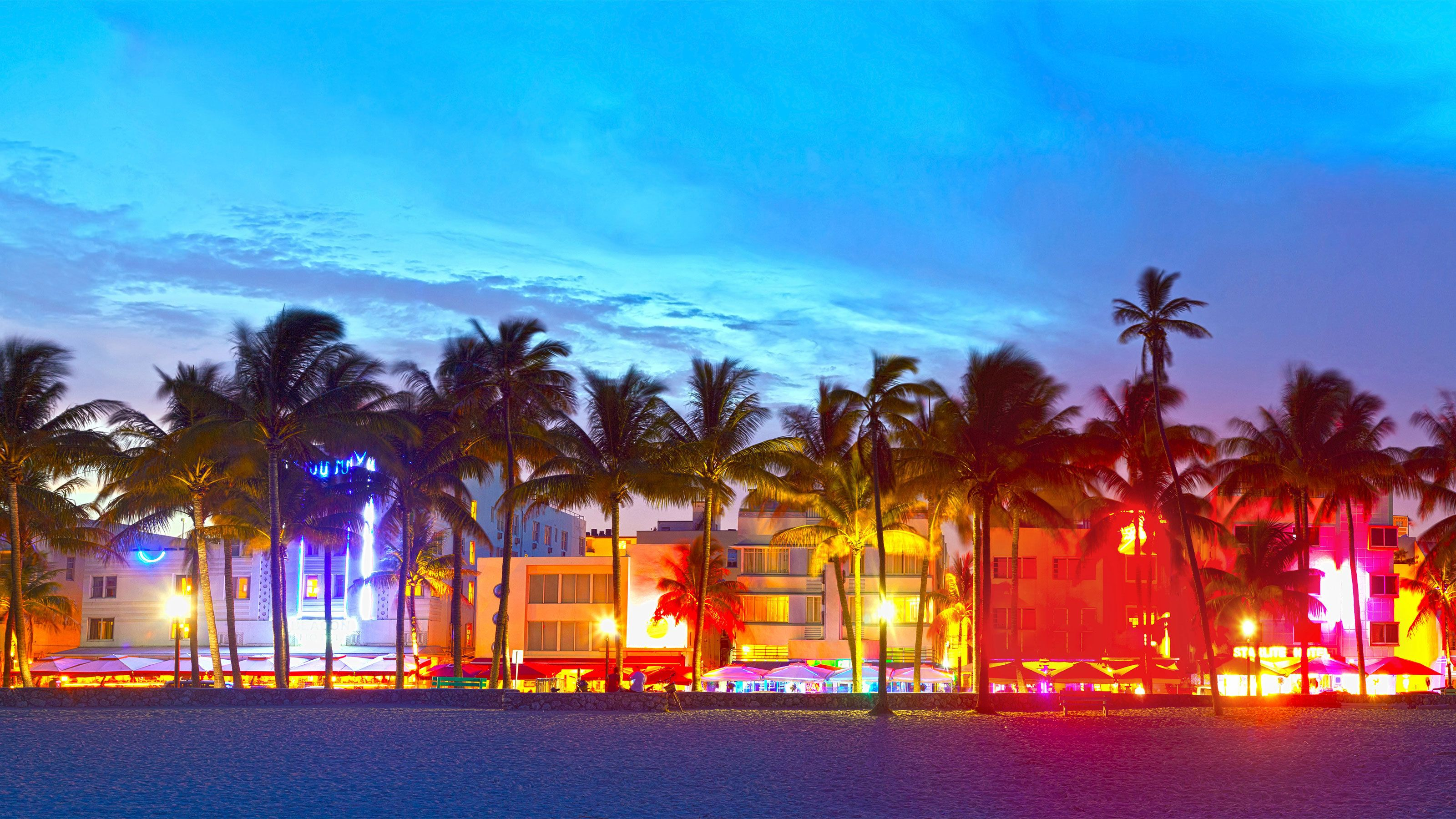 South Beach lit up with neon lights at night in Orlando.