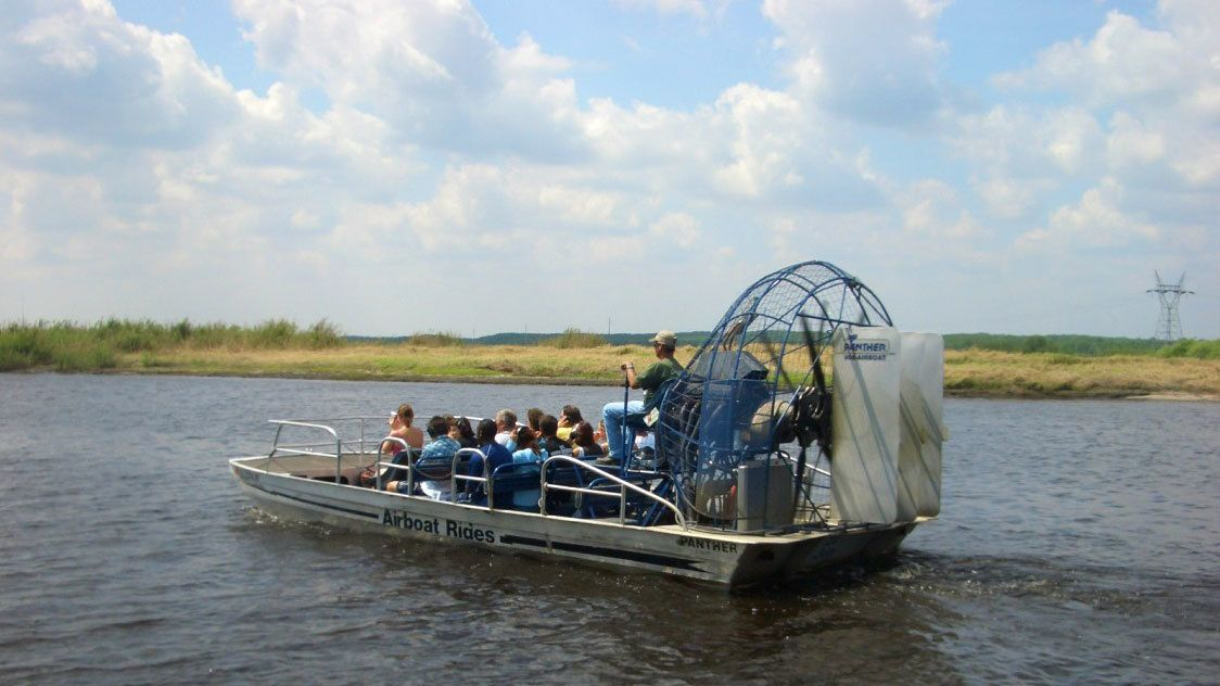 Airboat with passengers in the everglades in Orlando.