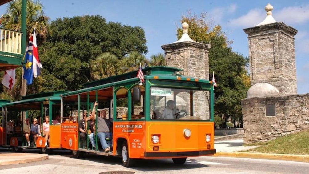 Show item 1 of 10. Trolley passing the Old City Gates in St. Augustine.