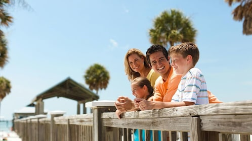 Happy family on boardwalk at Clearwater Beach in Florida.