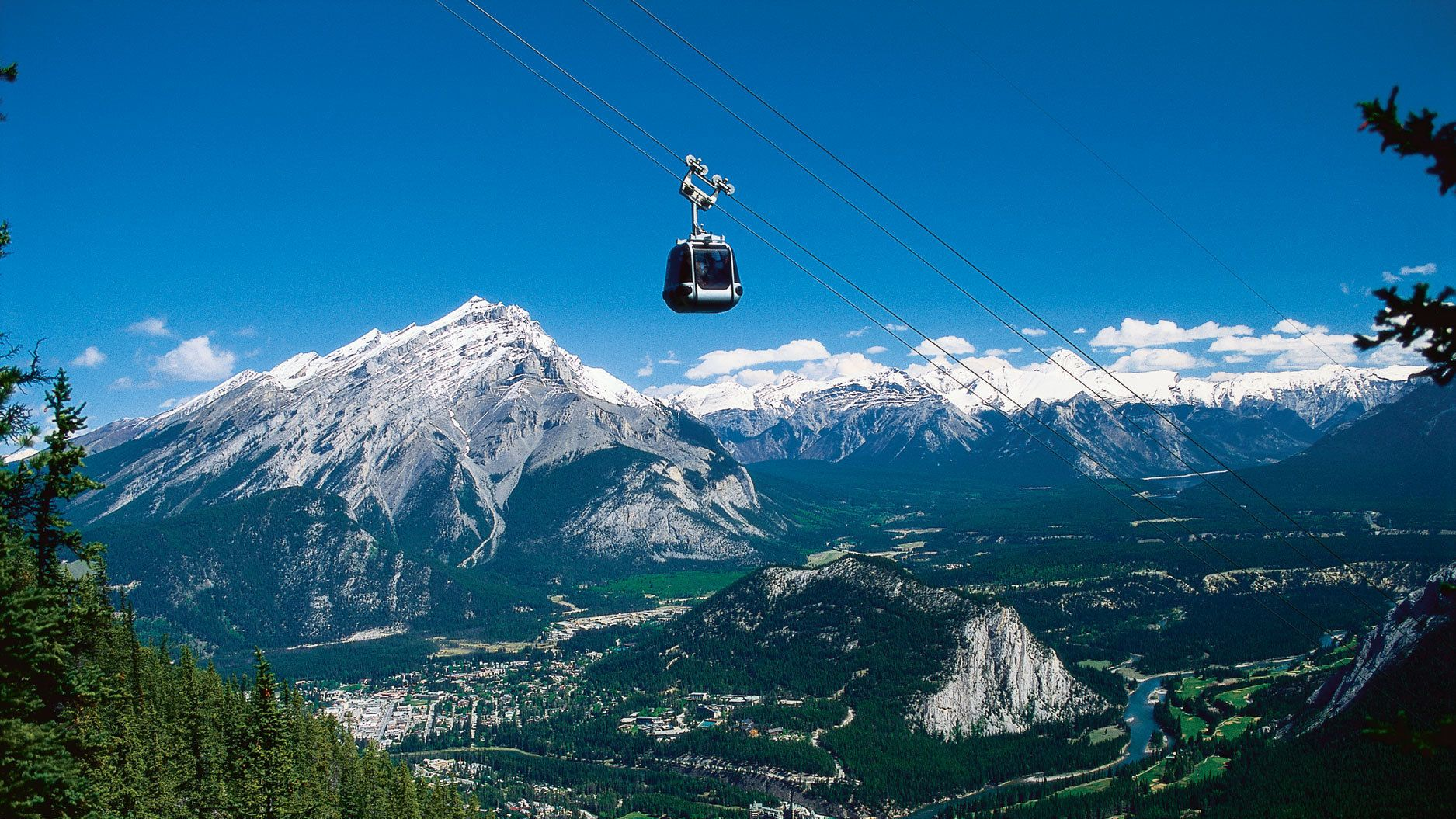 Hitch a ride on a gondola to Sulphur Mountain for a unique view of the Canadian Rockies