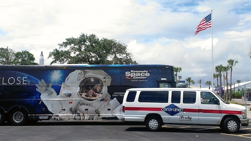 Gray Line tour van parked next to tour bust at Kennedy Space Center in Orlando