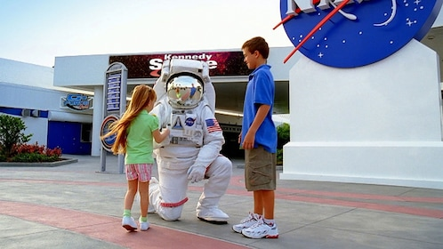 Astronaut with kids at Kennedy Space Center in Orlando.