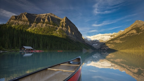 Lake Louise's pristine waters make perfect reflections of the surrounding Canadian Rockies