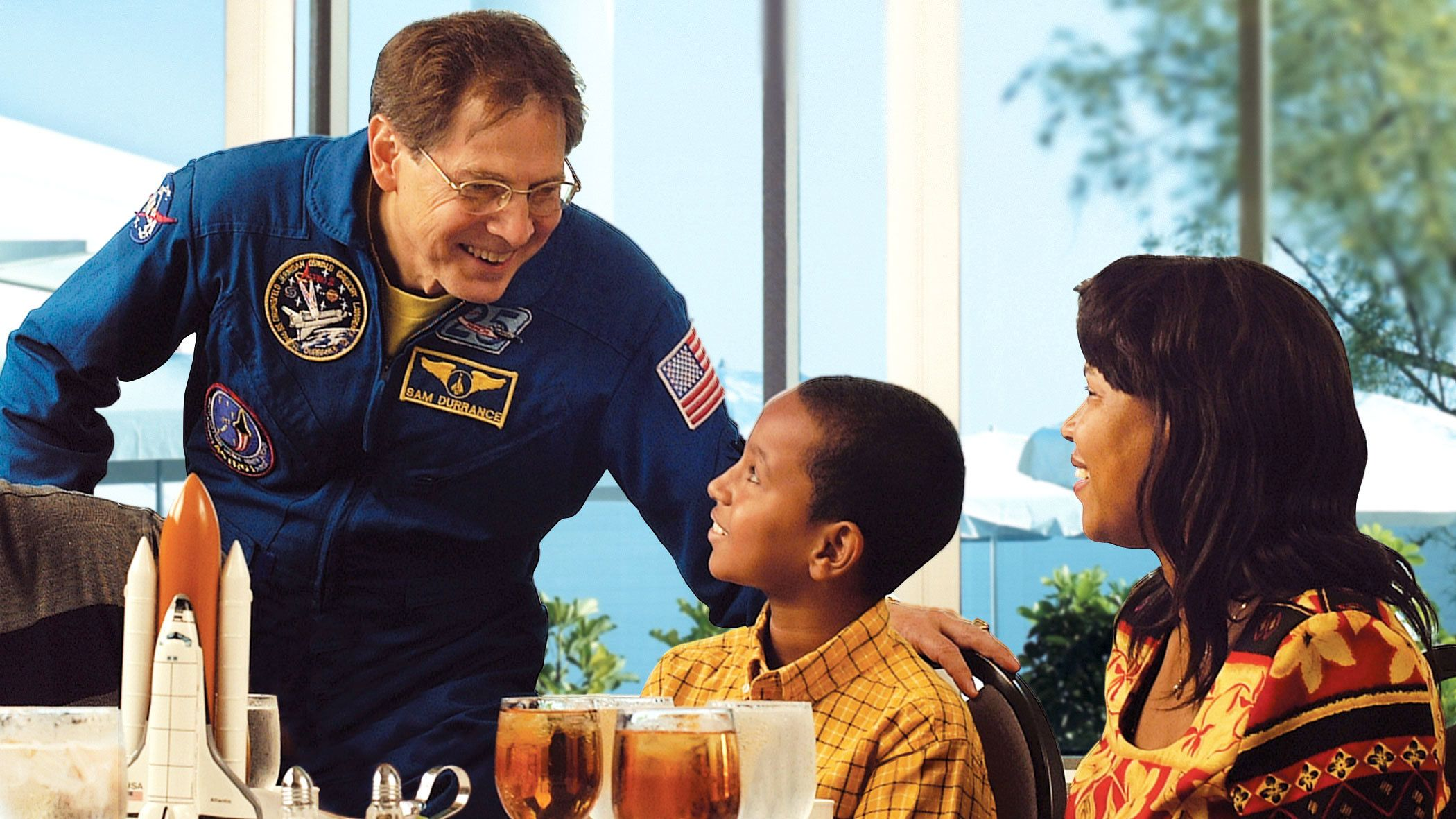 Astronaut talking to dining guests in Orlando.