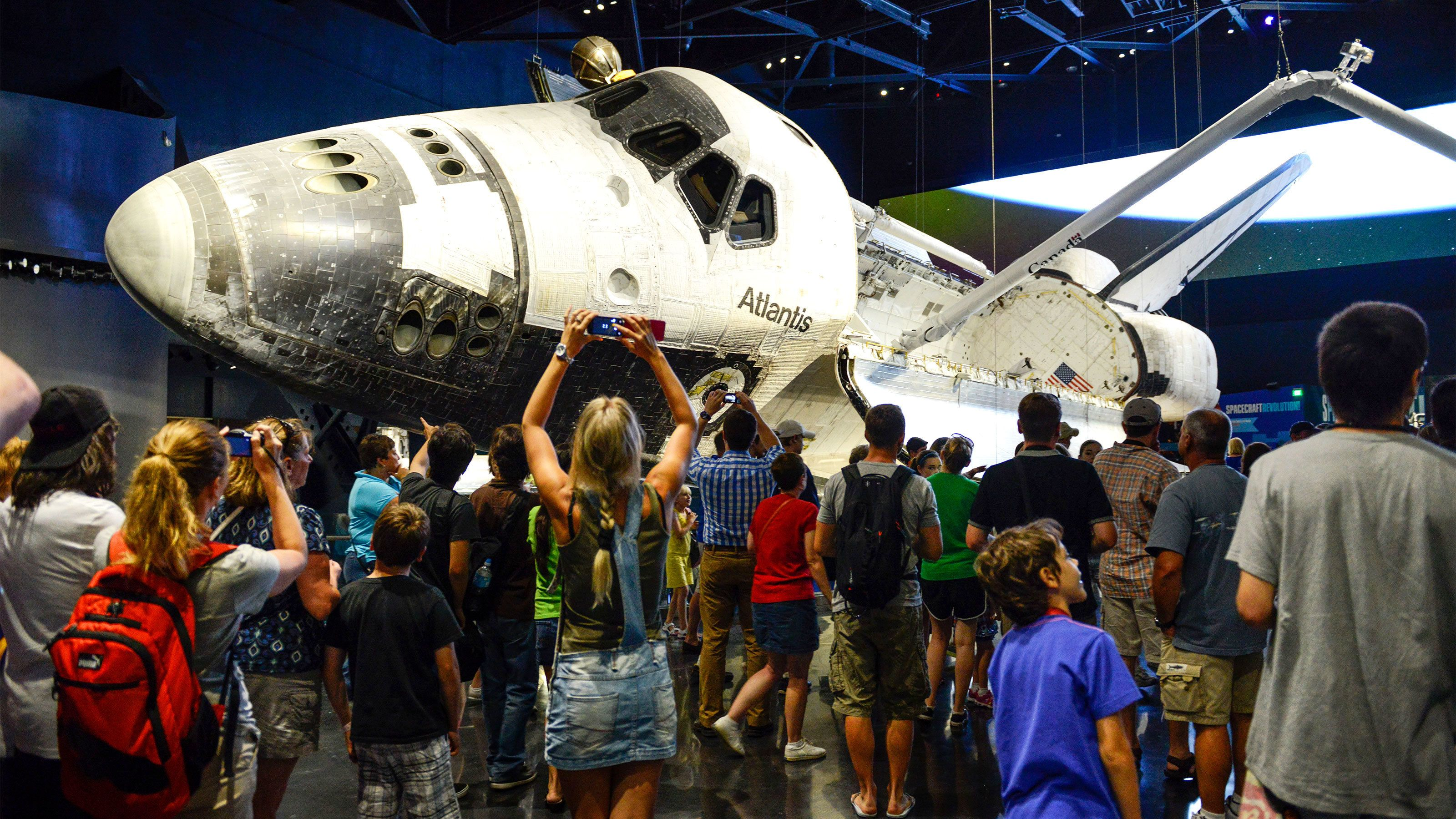 Space Shuttle Atlantis with crowd at the Kennedy Space Center in Orlando.