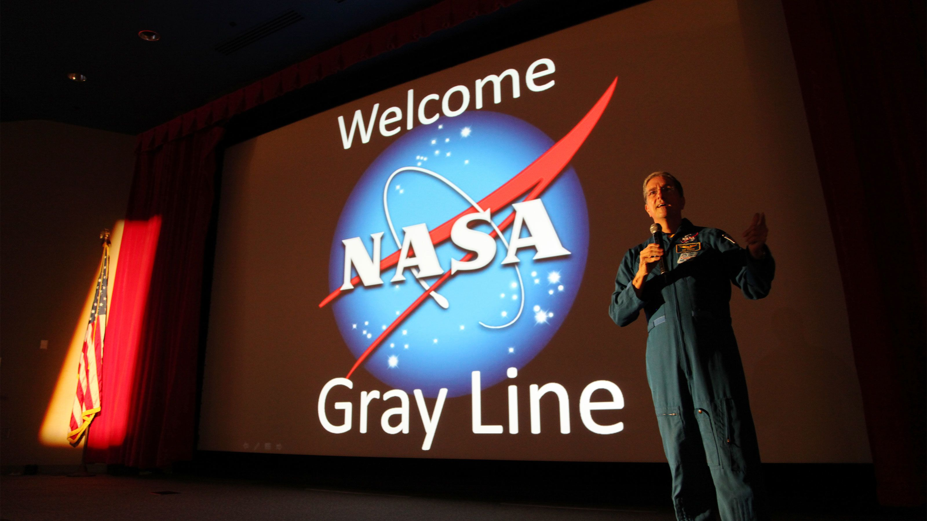 Kennedy Space Center staff member welcoming Gray Line tour in Orlando