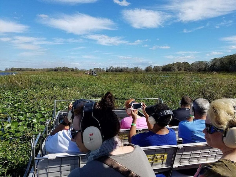 Show item 4 of 10. Airboat Ride with Transportation