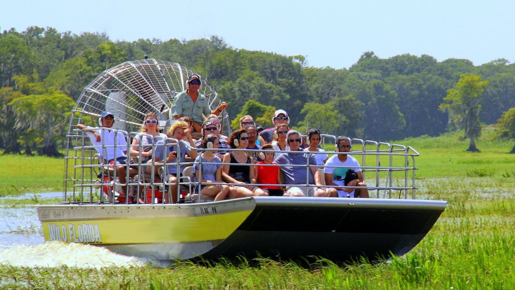 Show item 3 of 10. Airboat with group in the Everglades in Orlando.