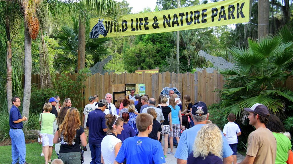 People gather outside of gate to Gatorland in Orlando