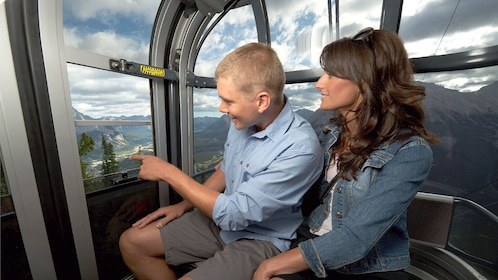 Experience scenic views of the Canadian Rockies while riding on a gondola to Sulphur Mountain
