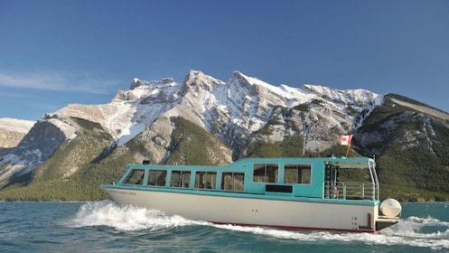Explore Lake Louise via tour boat and enjoy scenic views of the Canadian Rockies