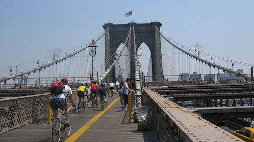 Bicycling group on the Brooklyn Bridge in New York