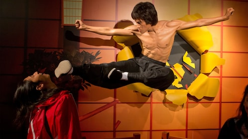 Girl at Bruce Lee exhibit at Madame Tussauds in San Francisco
