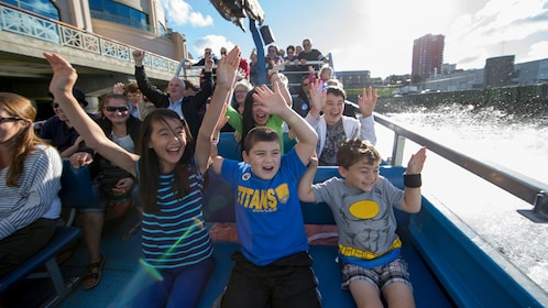 Harbour Hopper riders with hands in the air