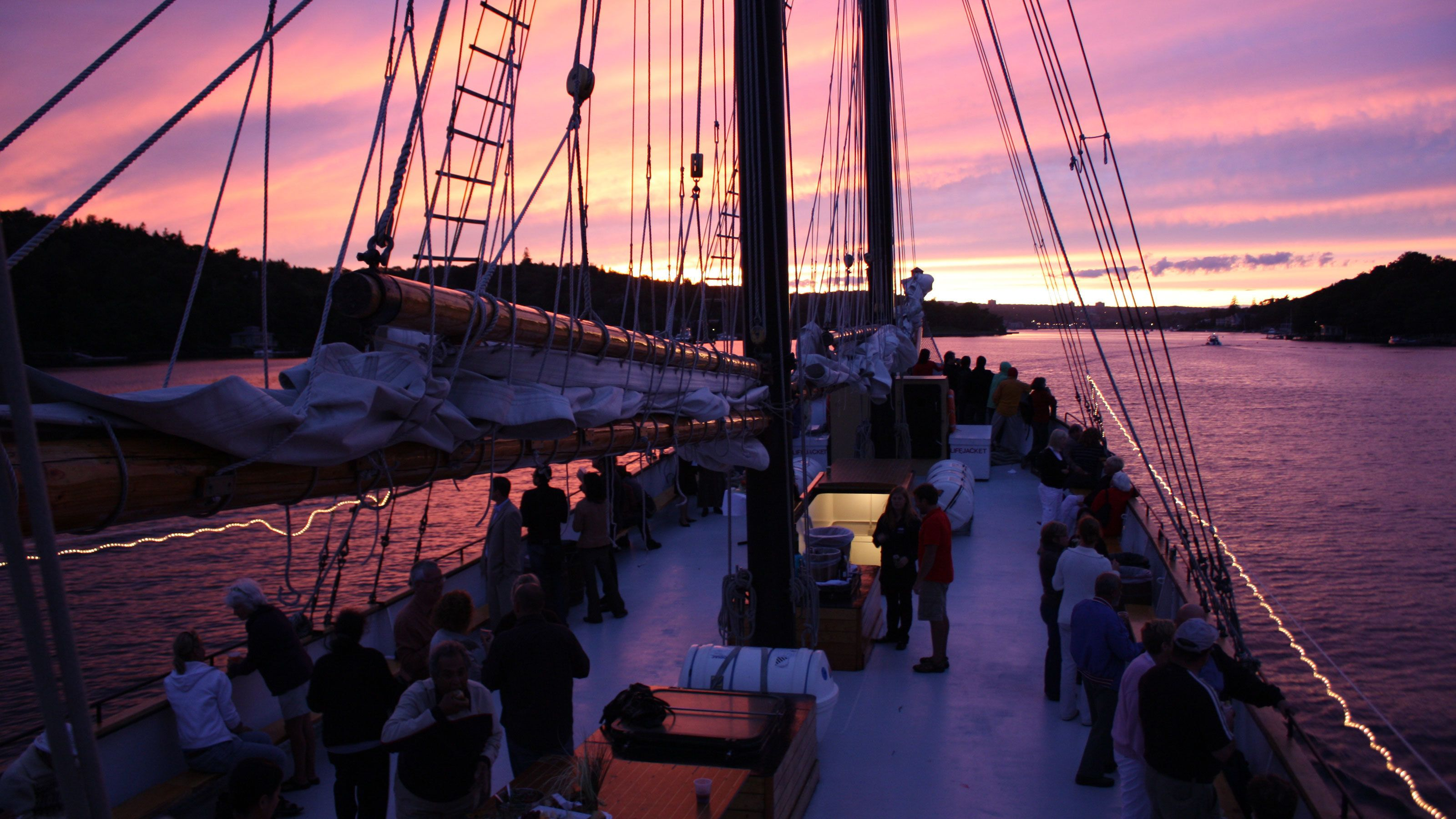 Tall Ship Silva deck with people at dusk