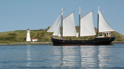 Tall Ship Silva sailing near lighthouse