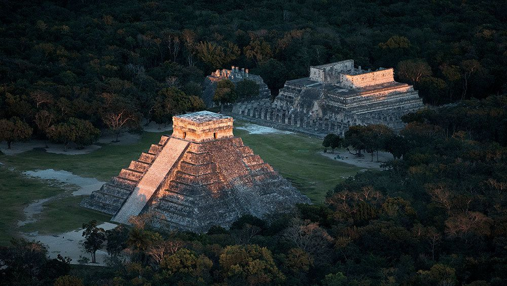 Aerial view of El Castillo Pyramid and Temple of the Warriors at Chichen Itza