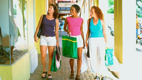 Shopping group of women with bags in outdoor shopping center.
