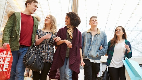 group of young adults shopping at a mall