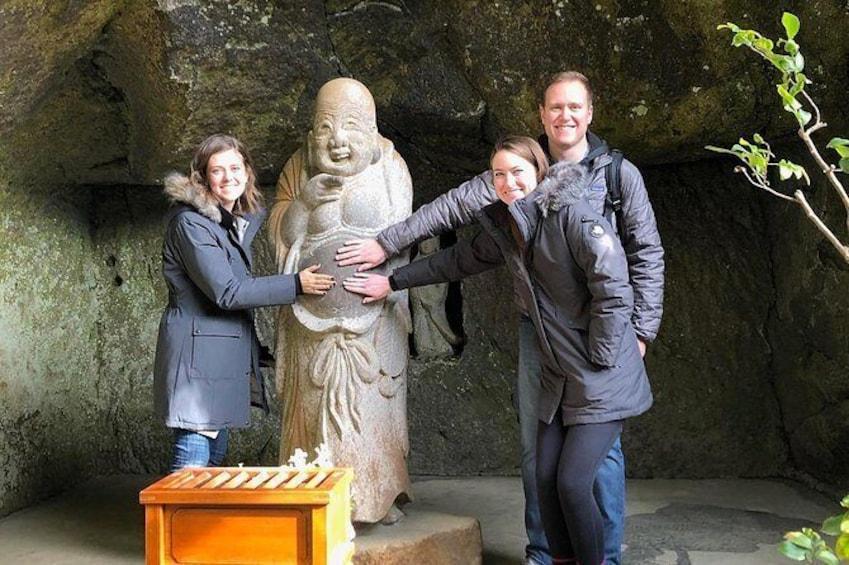 Touching Hotei at Jochiji Temple.