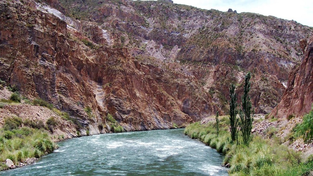 Show item 3 of 9. River running through a valley in Argentina
