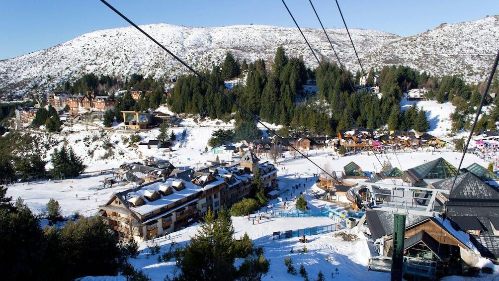 Show item 3 of 5. snowy village view in Bariloche