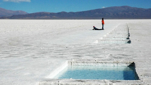 Row of square pools of clear water along the salt fields in Argentina