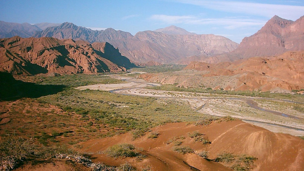 Green Calchaquí Valley surrounded by mountains in Argentina