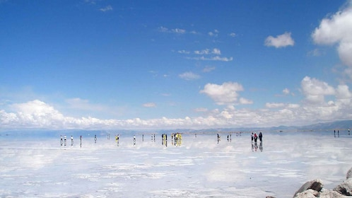 Tour groups walking along the salt desert in Salinas Grandes in Argentina
