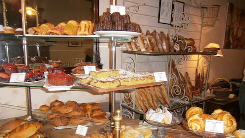 An assortment of bread on display at a bakery in Paris