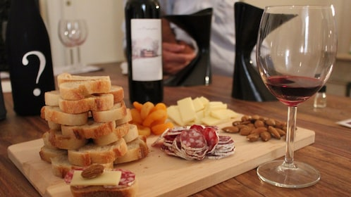 A wine a cheese pairing from a vineyard in France