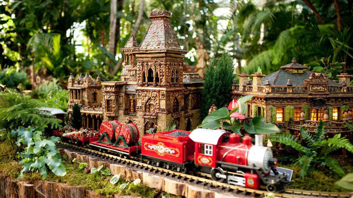 Model train traveling down track in New York Botanical Garden