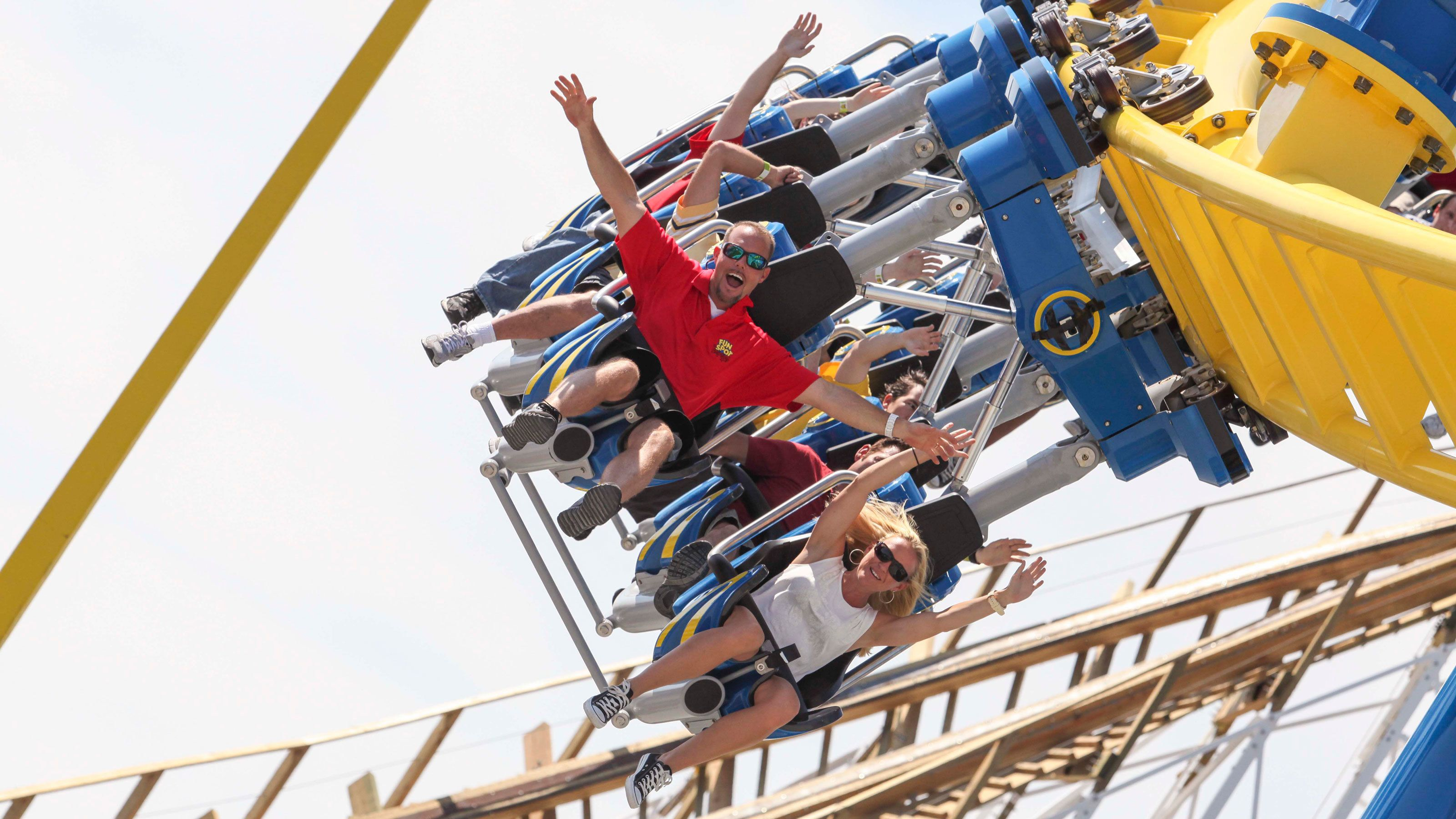 Inverted roller coaster with riders at Fun Spot America in Orlando.