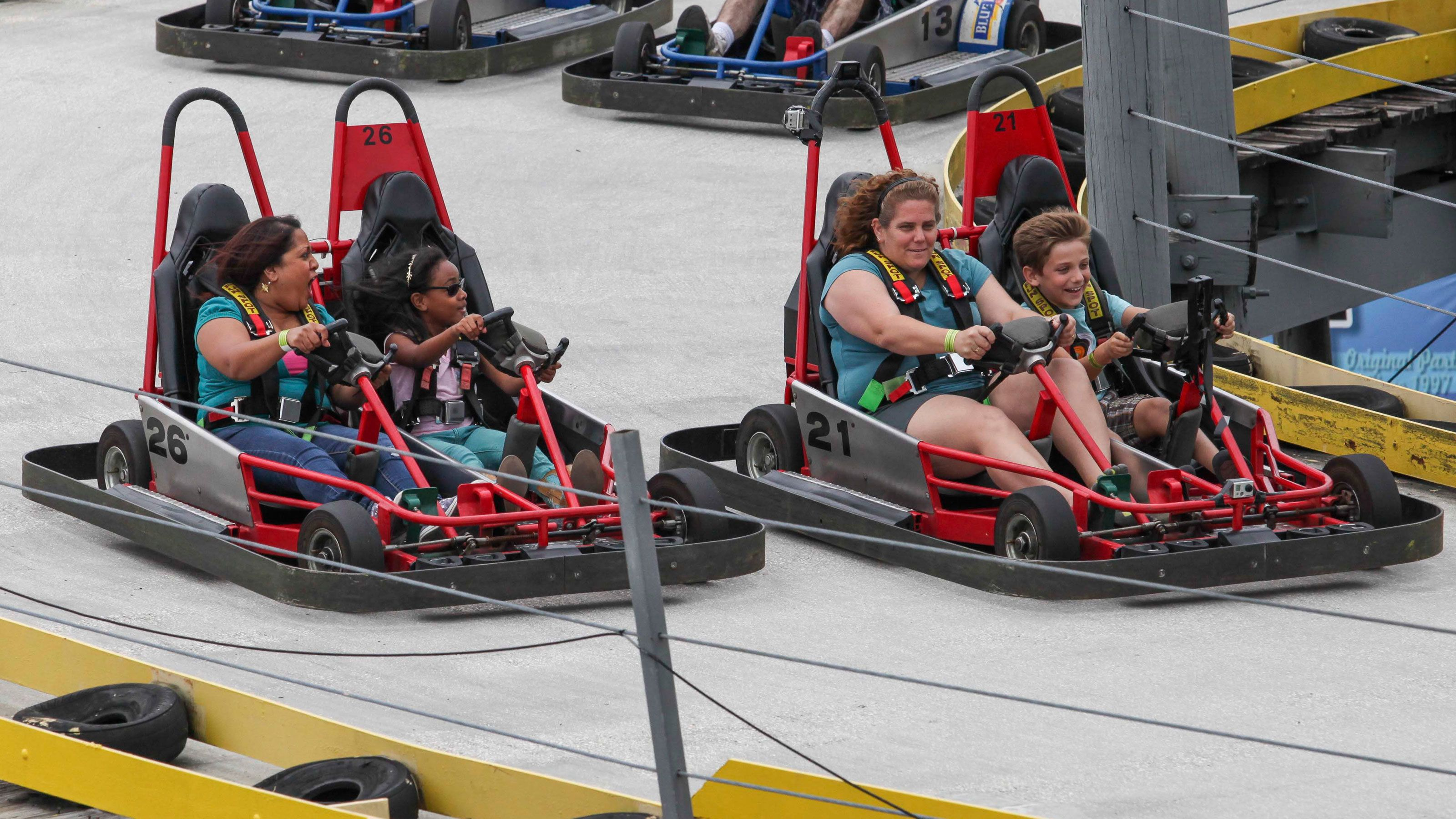 Go Karts with passengers at Fun Spot American in Orlando.