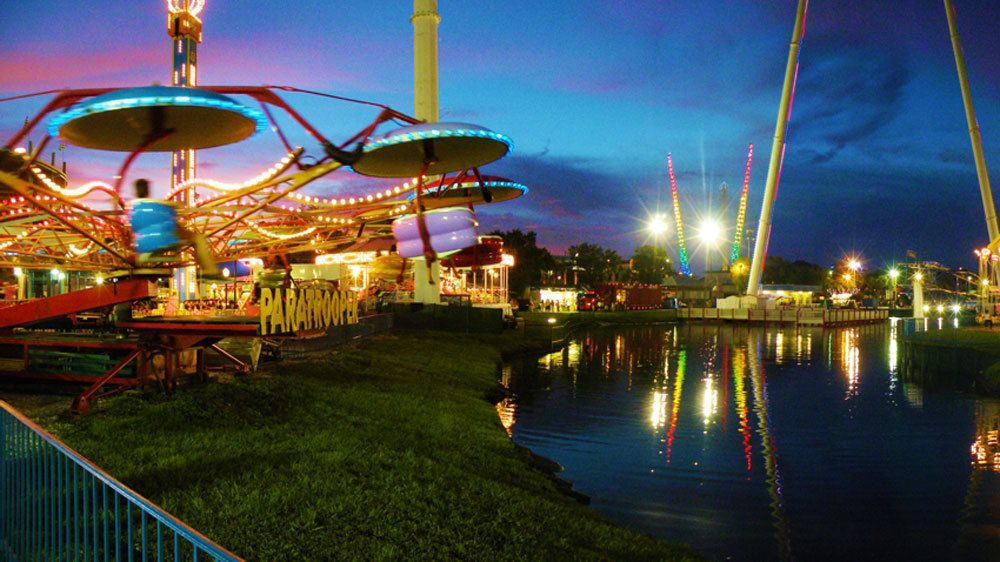Attractions at Fun Spot America lit up at night in Orlando.
