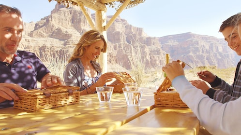 Group eating a picnic lunch at the Grand Canyon floor