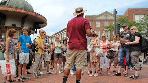 Tour guide with group at Harvard University in Boston