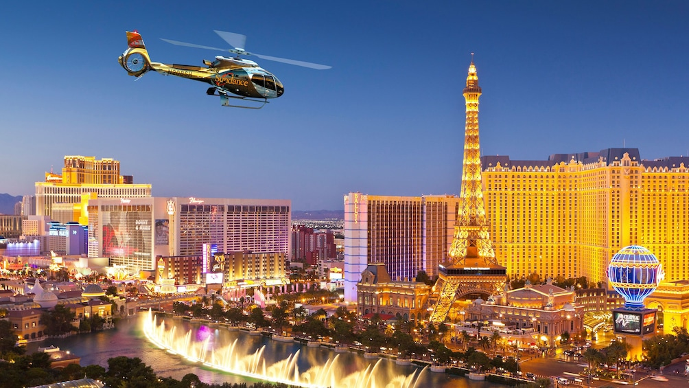 Show item 1 of 7. Helicopter flying above The Strip in Las Vegas