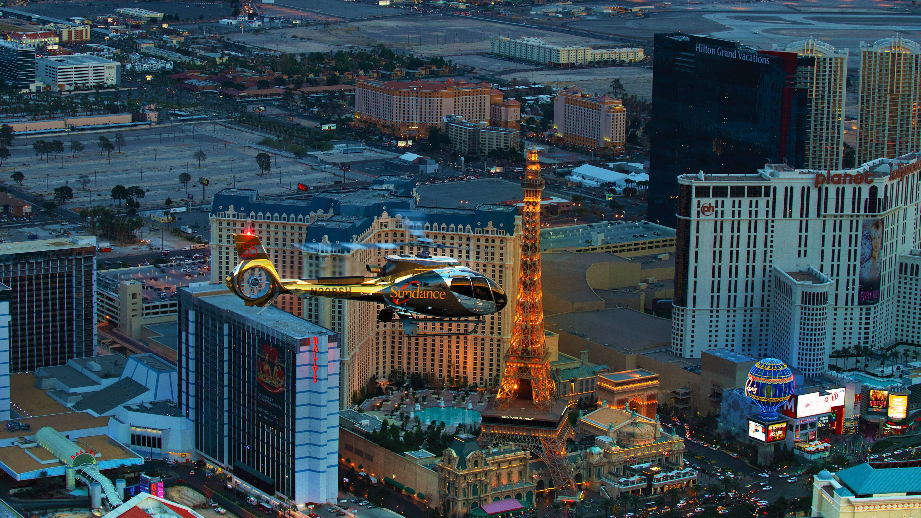 Helicopter flying above The Strip at night in Las Vegas