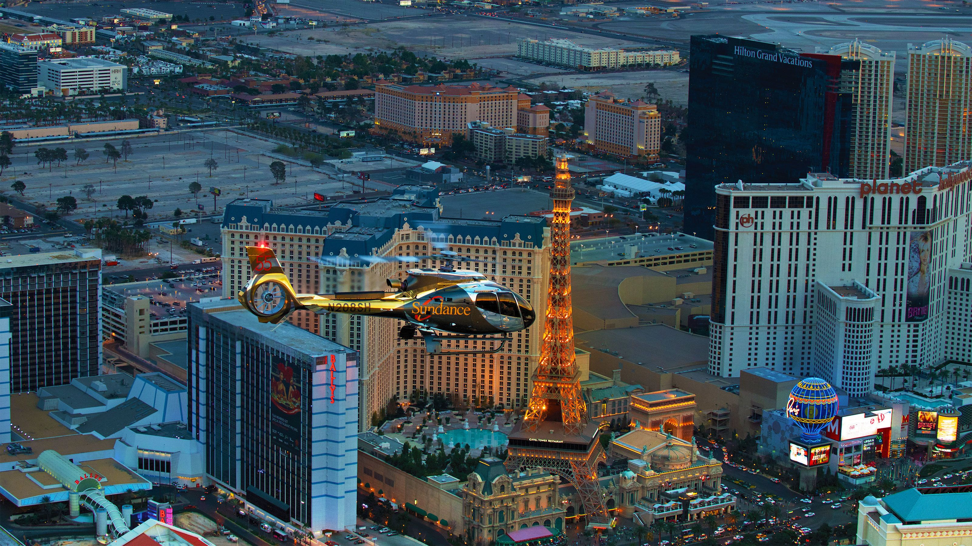 Helicopter flying above The Strip in Las Vegas at night