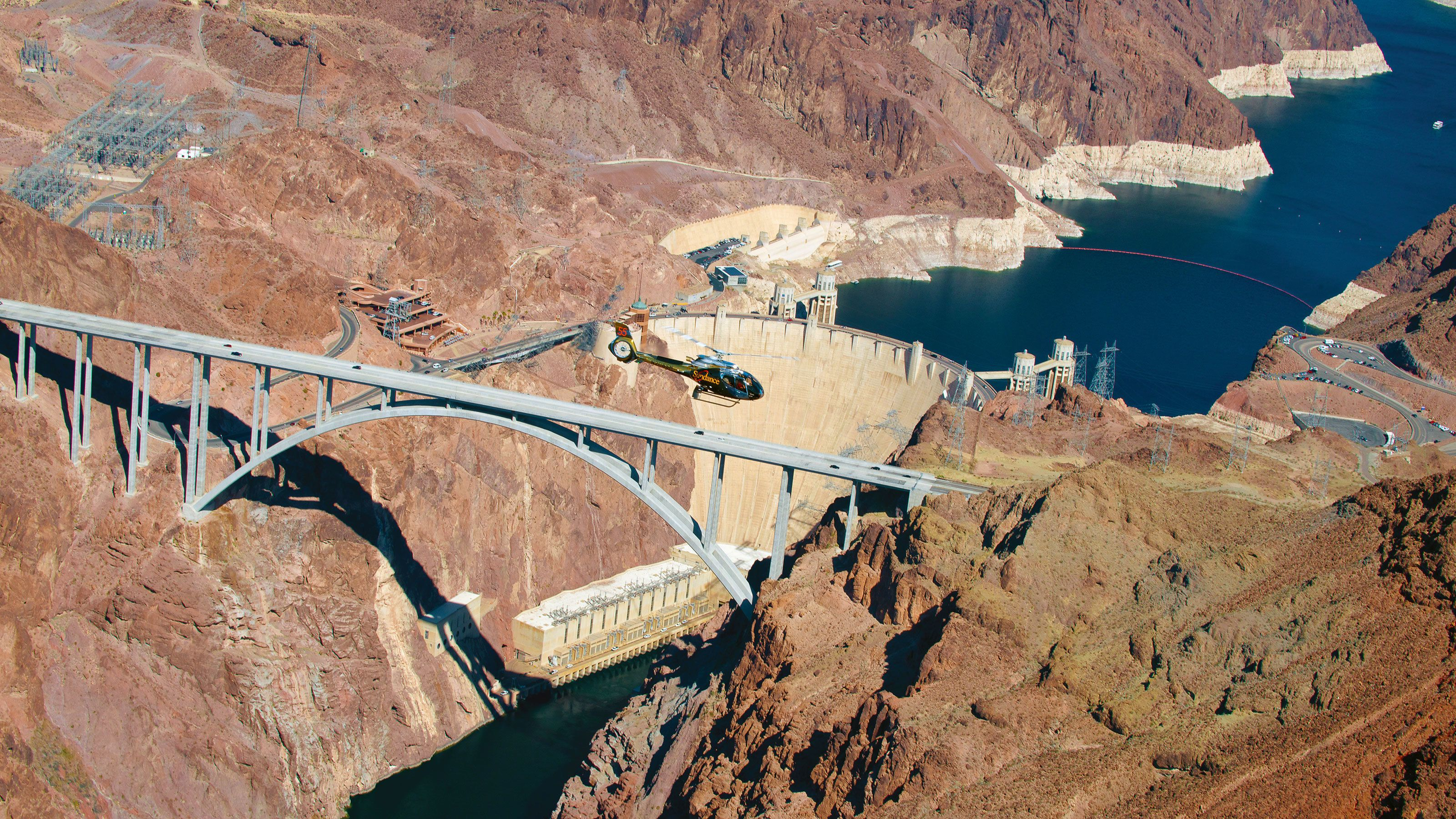 Helicopter flying above Hoover Dam